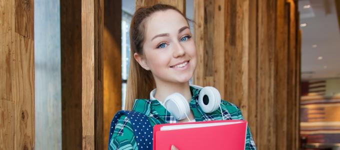 Student holding a folder